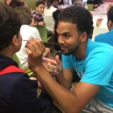 Face painting before evening activity