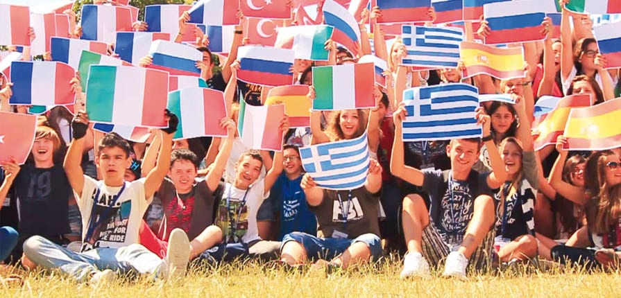 Junior students holding flags